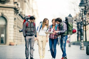 Happy Backpackers in the city.